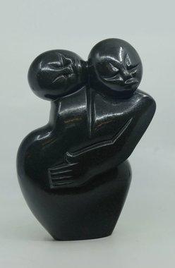 Stenen beeld uniek familie, Caring